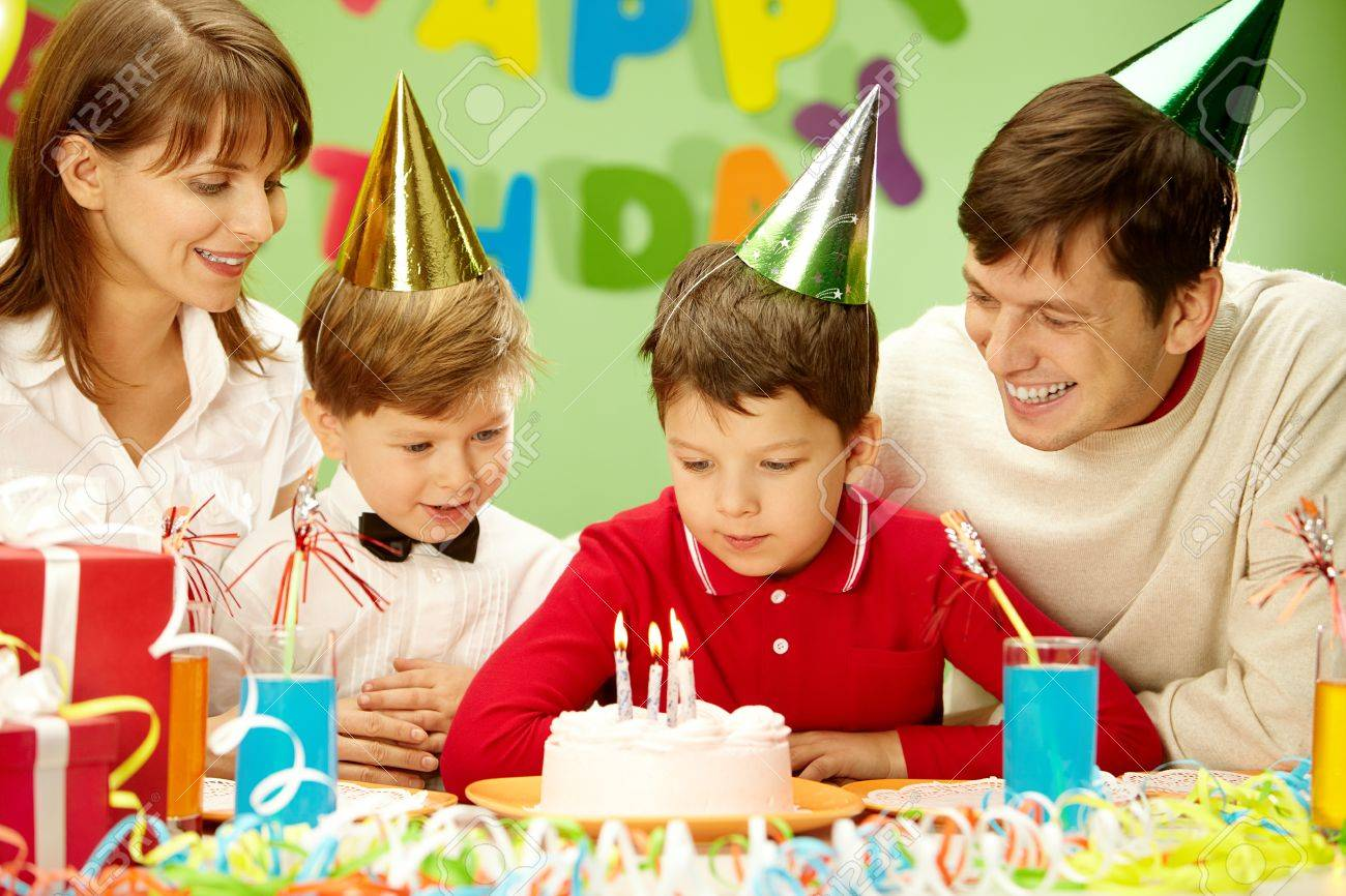 Portrait of family looking at holiday cake Stock Photo - 9726456
