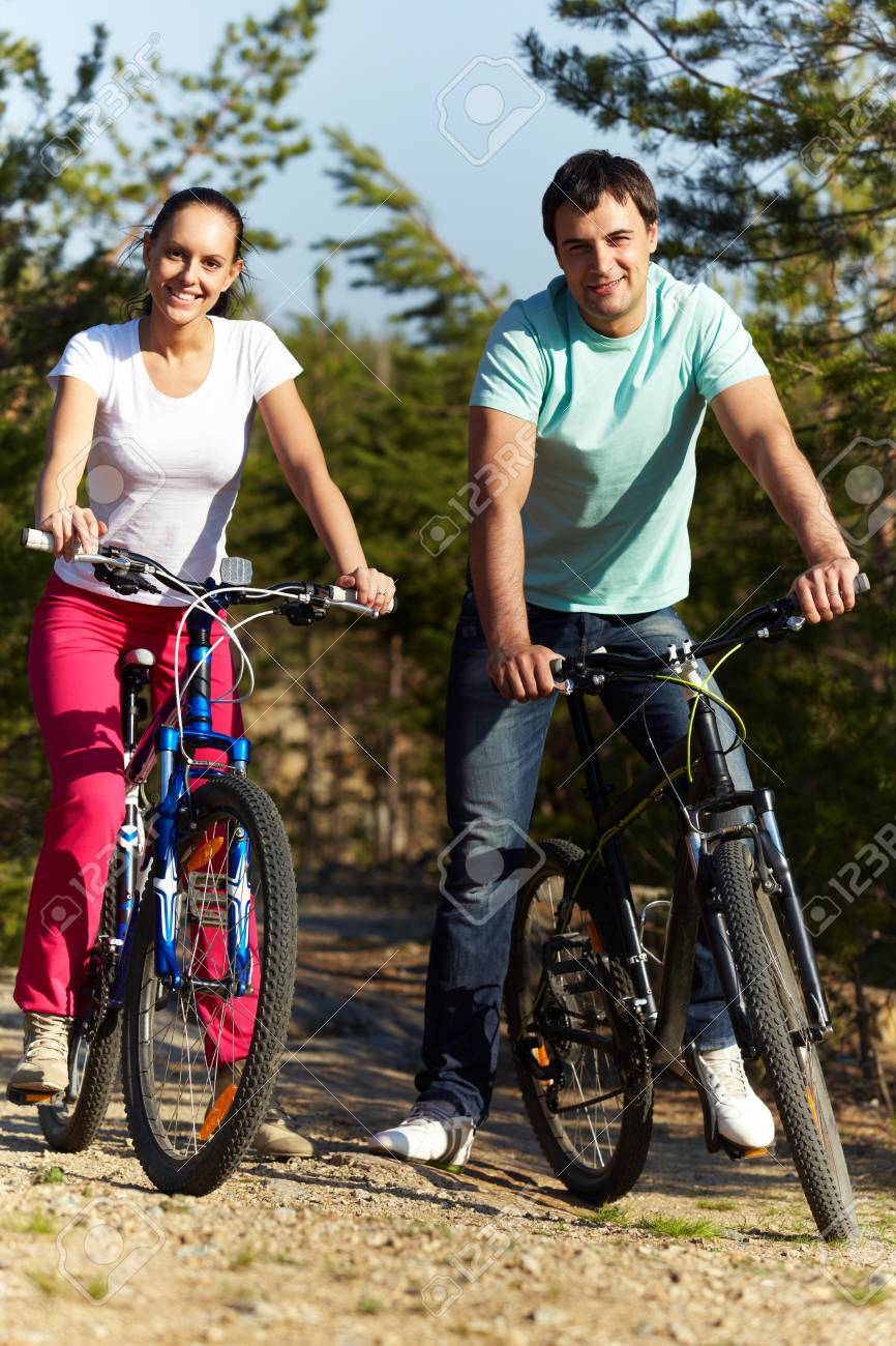 Portrait of an athletic couple on bicycles Stock Photo - 9727011