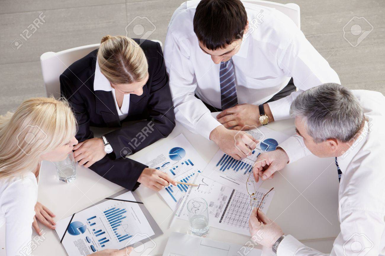 Above view of business team working with graphics Stock Photo - 9727273