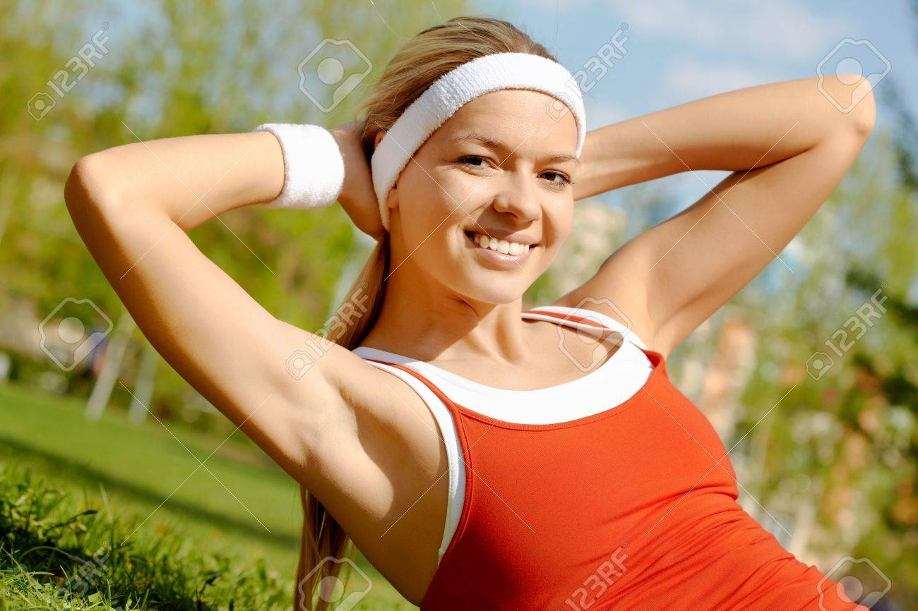 Portrait of a young woman doing physical exercise outdoors Stock Photo - 9805156