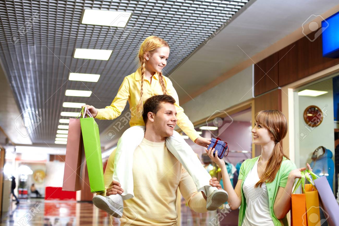 Image of family with paperbags and giftbox in the mall Stock Photo - 9821900