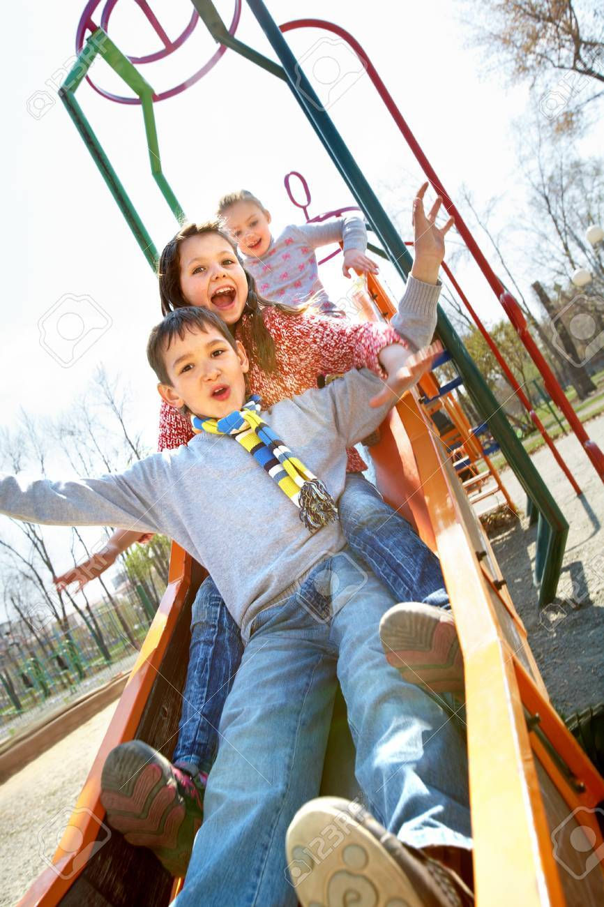 Portrait of happy children having fun outside Stock Photo - 9821792