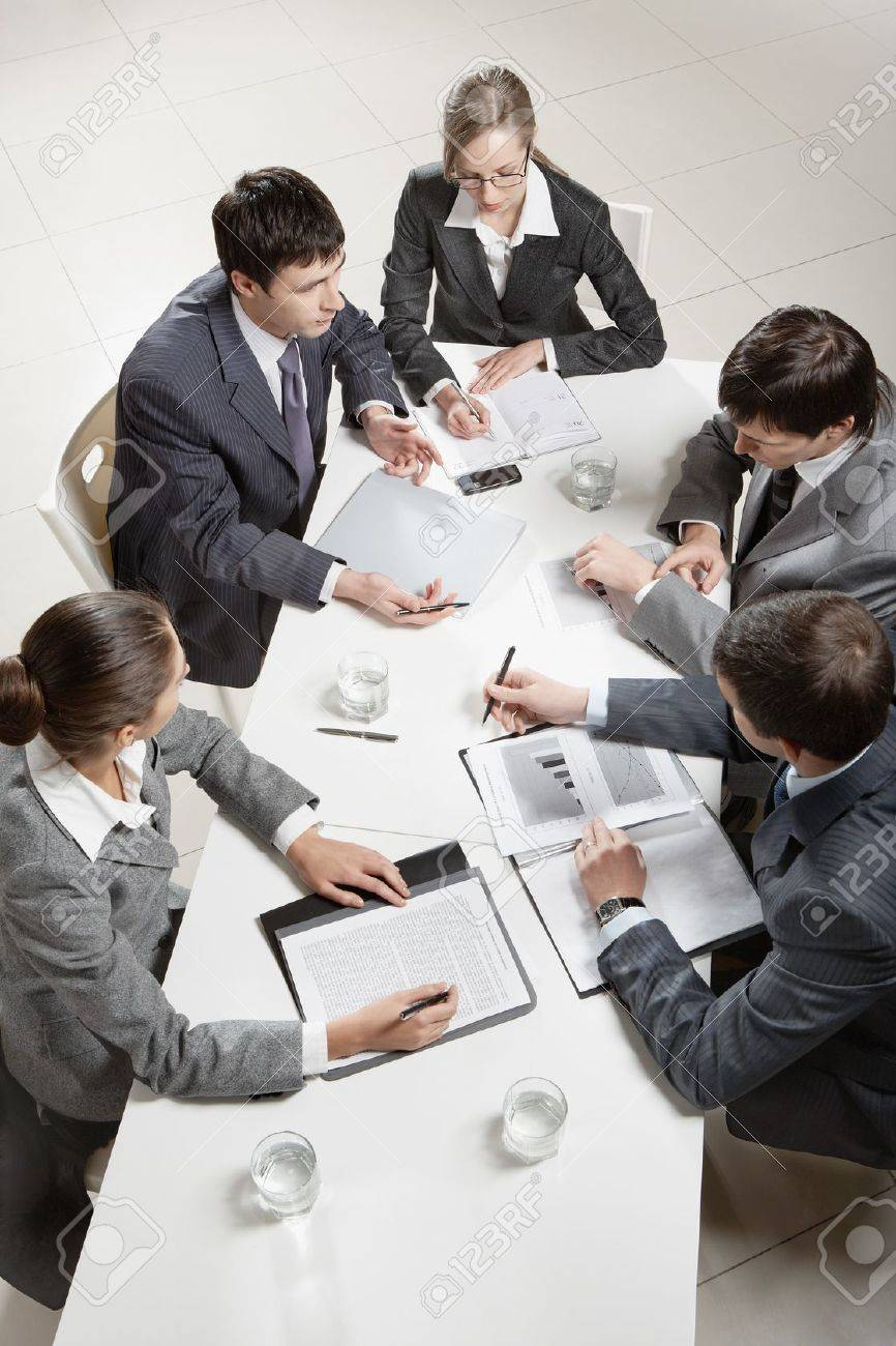 Team of five business people discussing an important question at briefing Stock Photo - 9821832