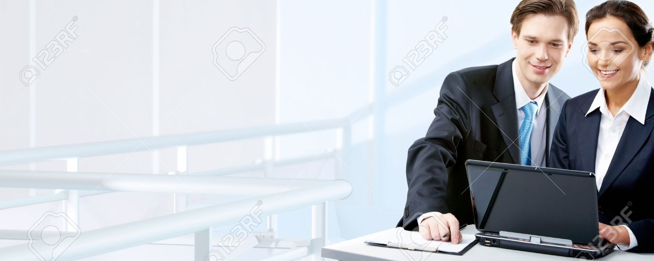 Image of two working people looking at laptop screen in office Stock Photo - 9821801