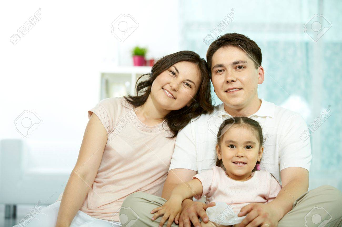 Portrait of happy parents with daughter looking at camera Stock Photo - 9818989