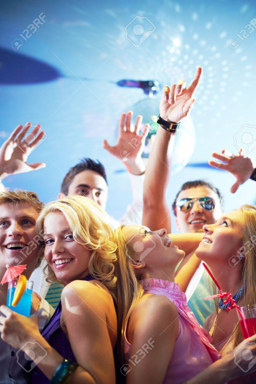 Portrait of cheerful friends dancing and having fun at party in club Stock Photo - 9817893
