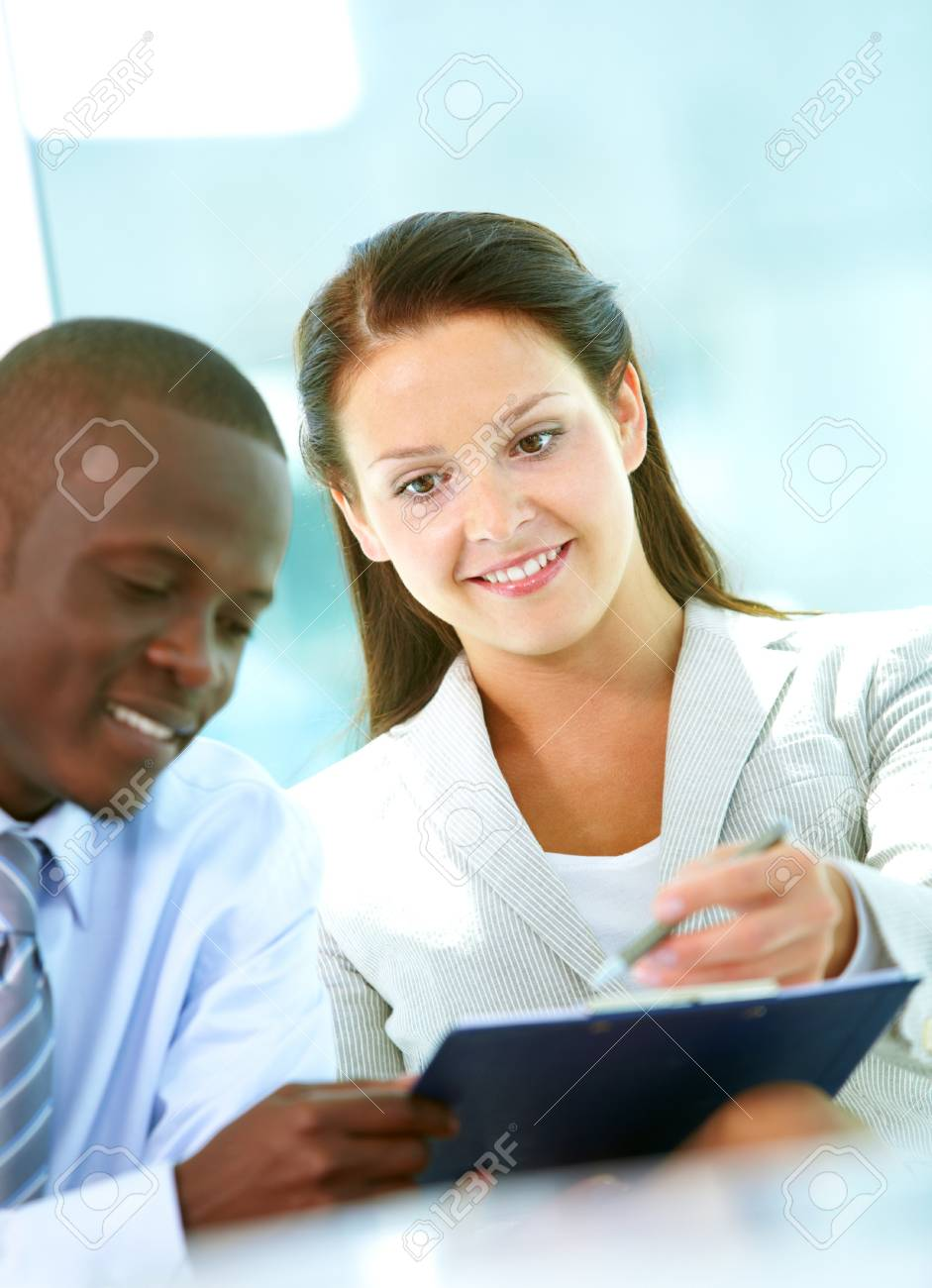 Portrait of successful partners discussing plan in office Stock Photo - 9818563