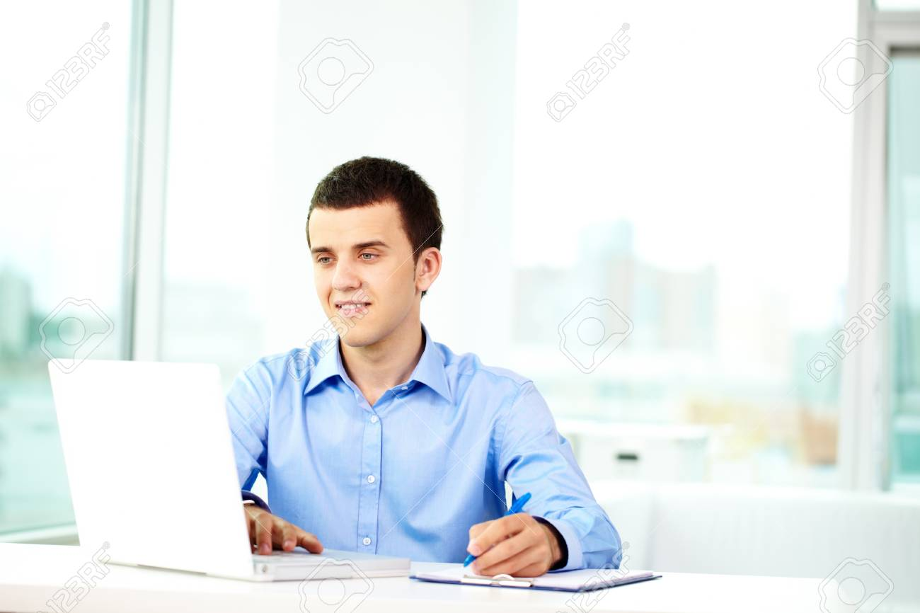 Portrait of successful businessman working on computer Stock Photo - 9910457