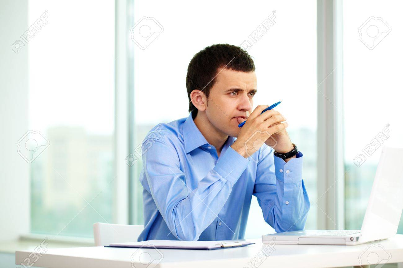 Portrait of pensive businessman thinking of something in office Stock Photo - 9910460