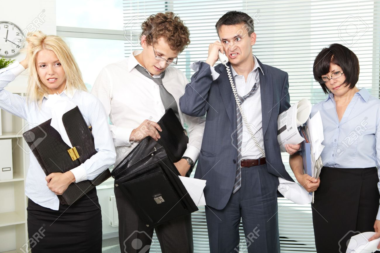 group of tired and annoyed businesspeople after hard working group of tired and annoyed businesspeople after hard working day stock photo 9910714