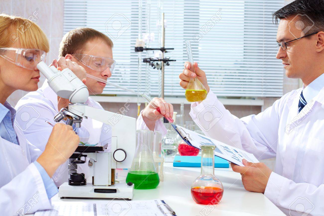 Serious clinicians studying new medicine in laboratory Stock Photo - 9910748