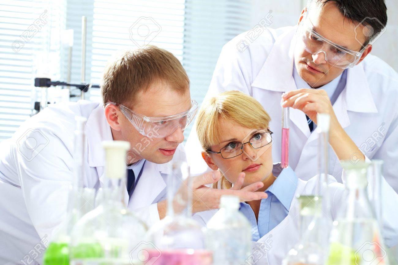 Three chemists researching liquid in tubing Stock Photo - 9908321