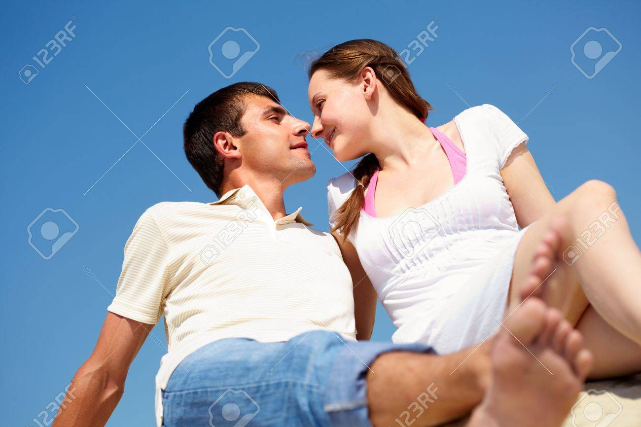 peaceful couple looking at each other with blue sky on background Stock Photo - 9910818