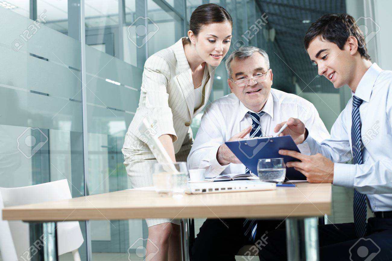 Young manager showing plan to his colleagues Stock Photo - 9963077