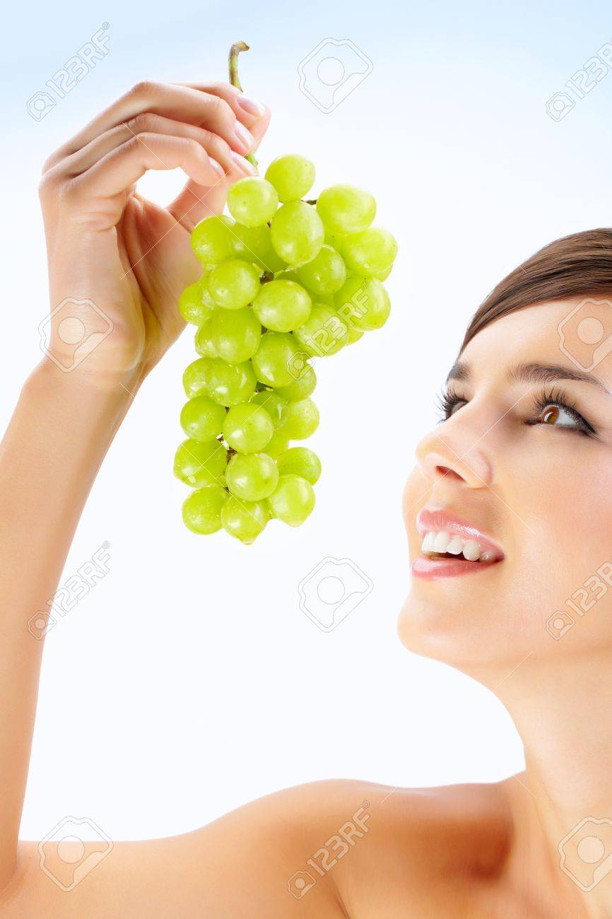 A beautiful woman holding green grape Stock Photo - 9963220