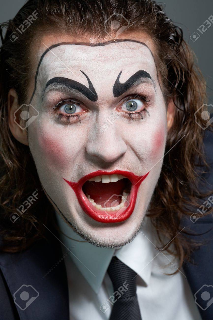 Portrait of businessman with theatrical makeup making a face Stock Photo - 9963171