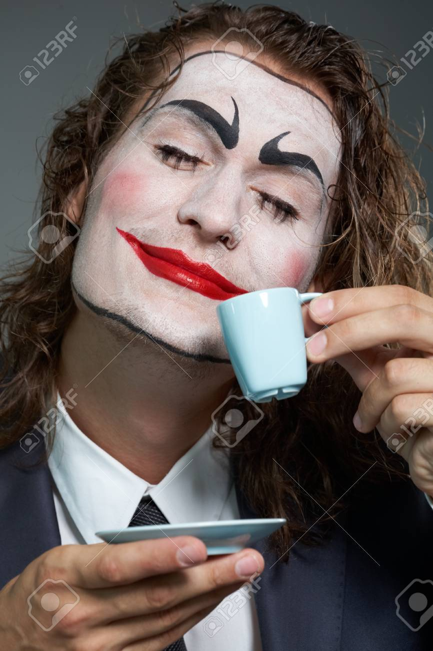Portrait of businessman with painted face drinking coffee Stock Photo - 9963153