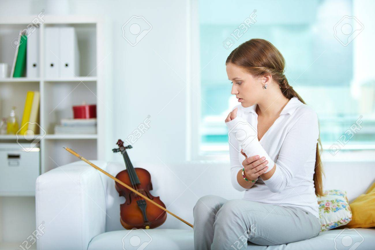 Portrait of a young violinist with broken arm Stock Photo - 10068814