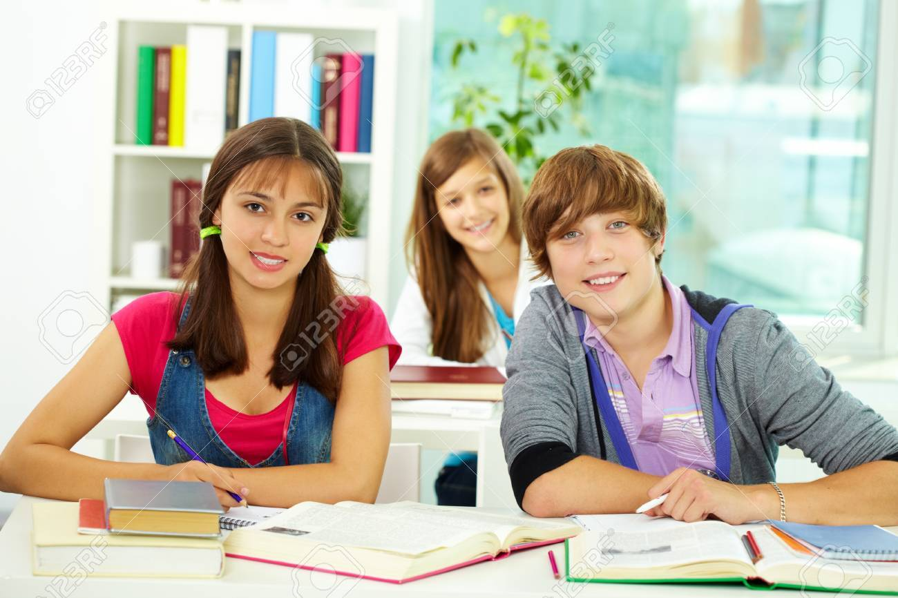 Portrait of smart classmates looking at camera during lesson Stock Photo - 10175320