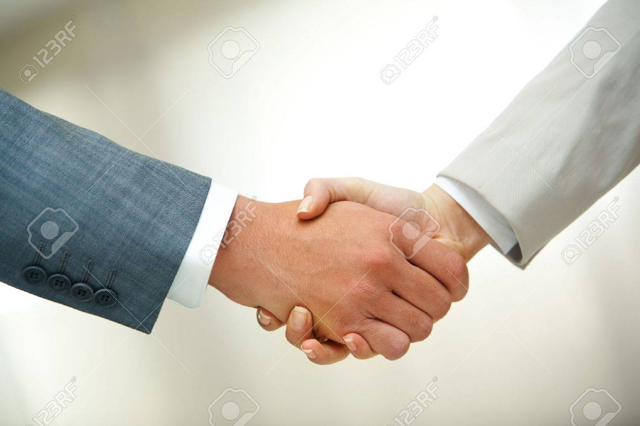 Photo of handshake of business partners after signing contract Stock Photo - 10251484