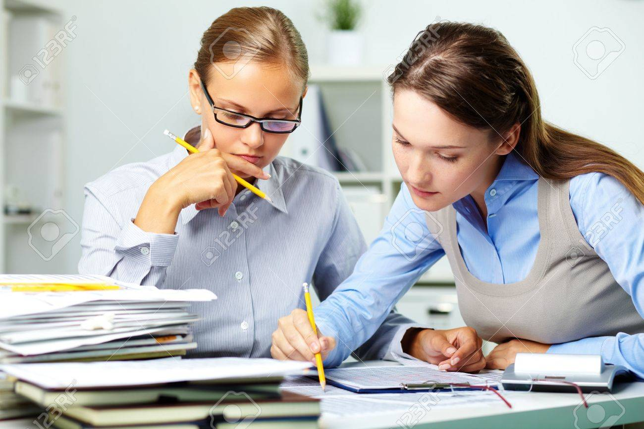 Portrait of two businesswomen working with papers in office Stock Photo - 10289790