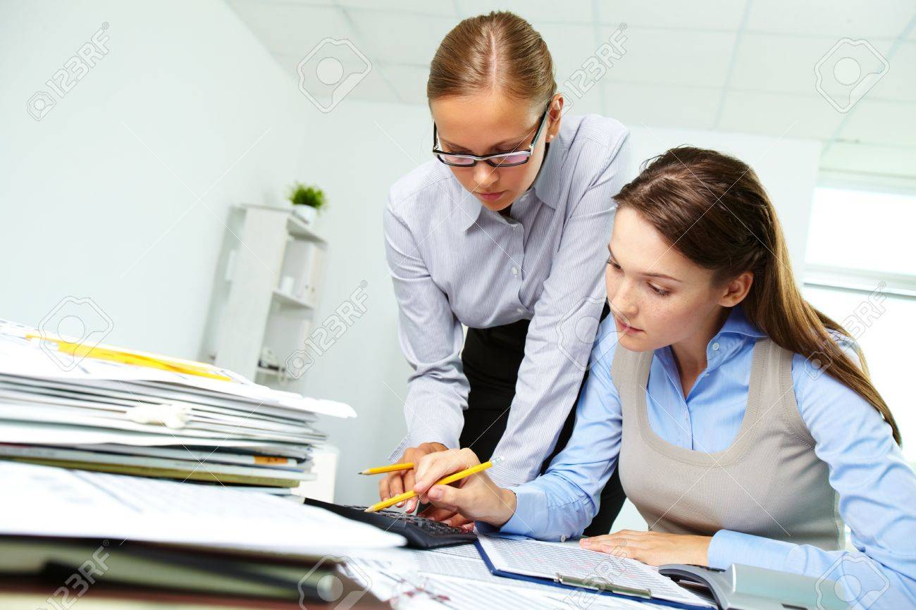 Portrait of two businesswomen working with papers in office Stock Photo - 10289792
