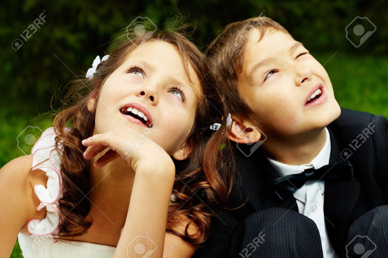 portrait of cute boy groom and girl bride stock photo, picture and