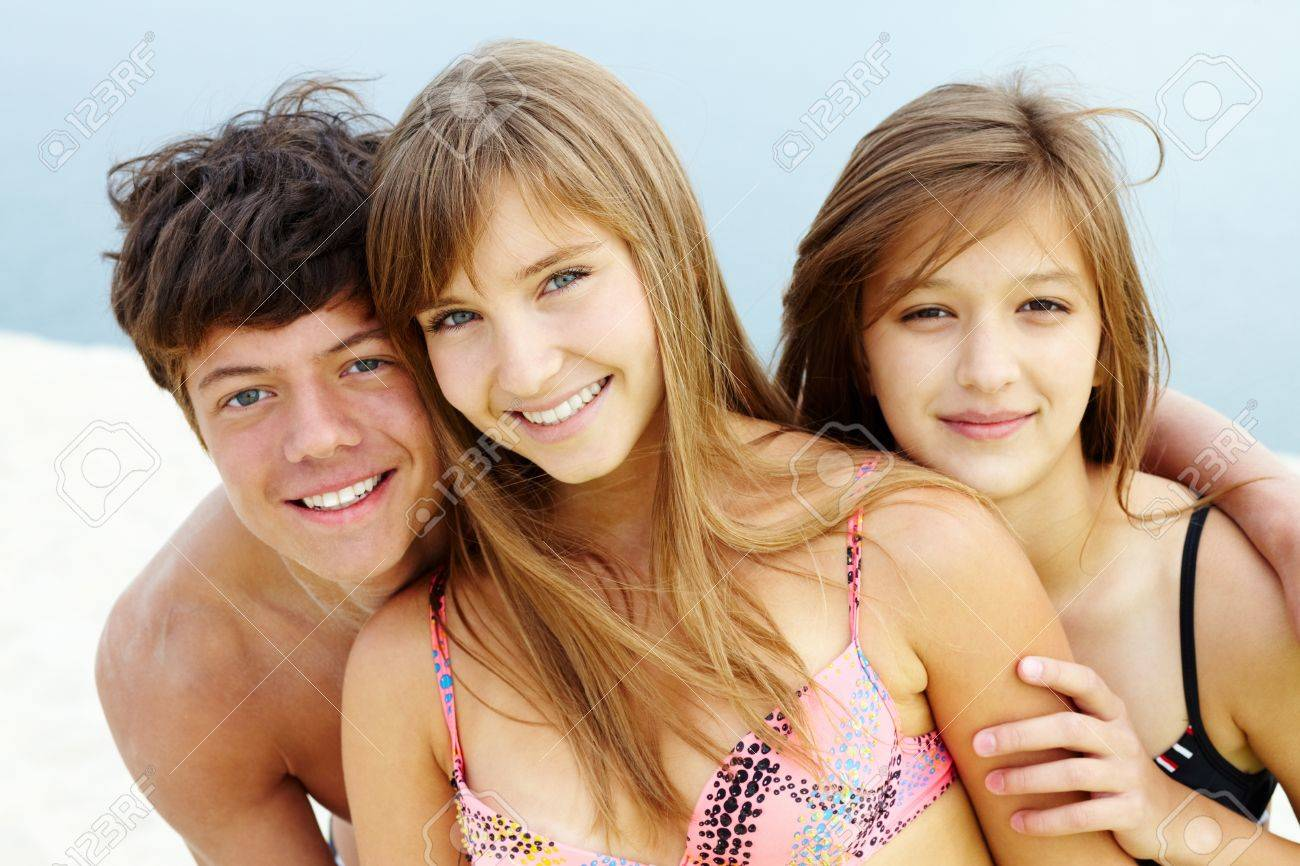 8c04d2d8ad35 Portrait of happy teenage guy and two pretty girls Stock Photo - 10490949
