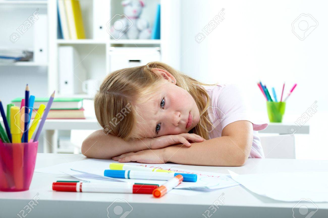 Portrait of sad girl putting her head on desk Stock Photo - 10490926