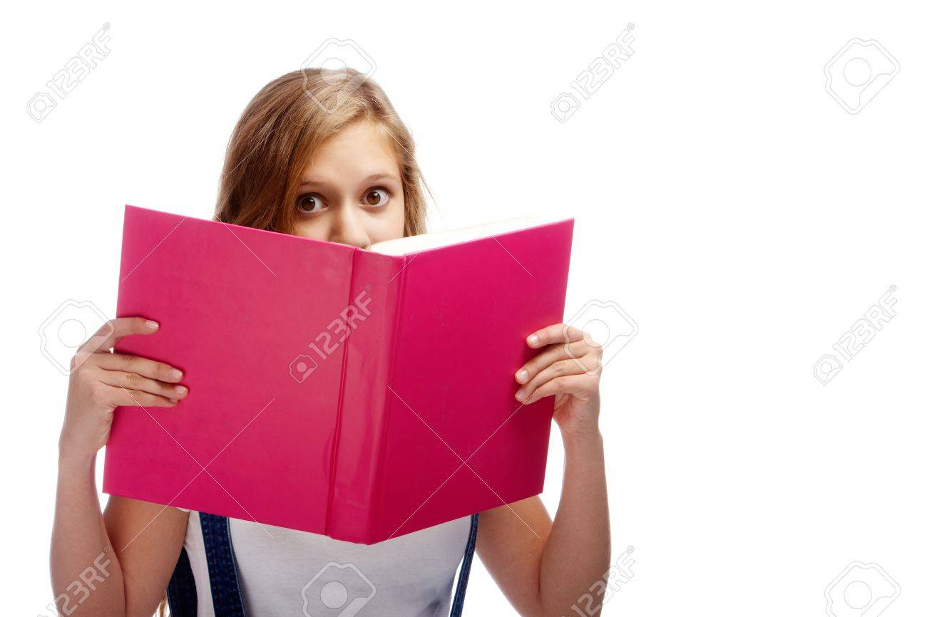 Cute girl peeking out of open book while reding it in isolation Stock Photo - 10562634
