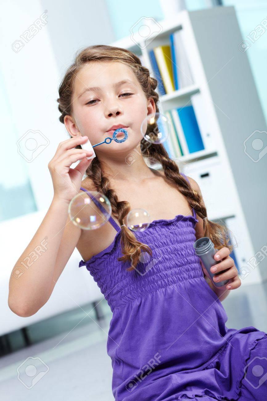 Portrait of cute girl blowing soap bubbles Stock Photo - 10597269