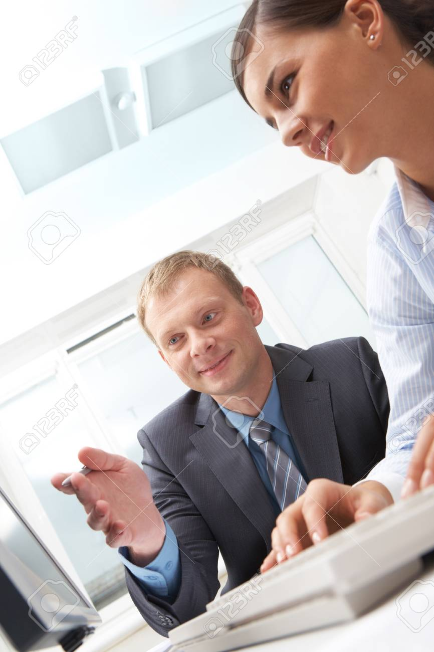 Manager showing to secretary her work at monitor Stock Photo - 10695243