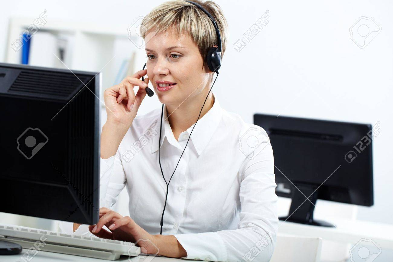 Young secretary with headset answering a call Stock Photo - 10699929