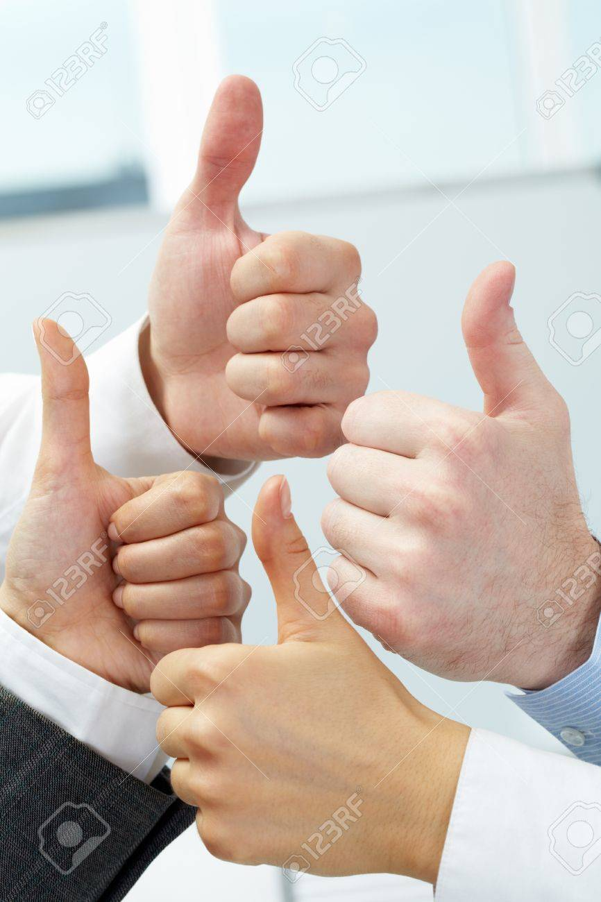 Close-up of four hands showing big thumbs Stock Photo - 10864338