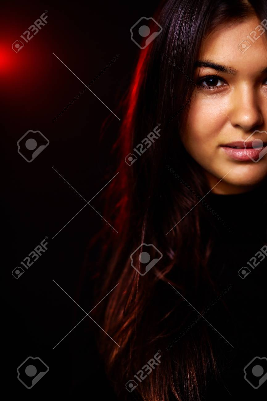 Portrait of young woman in the dark Stock Photo - 10882250