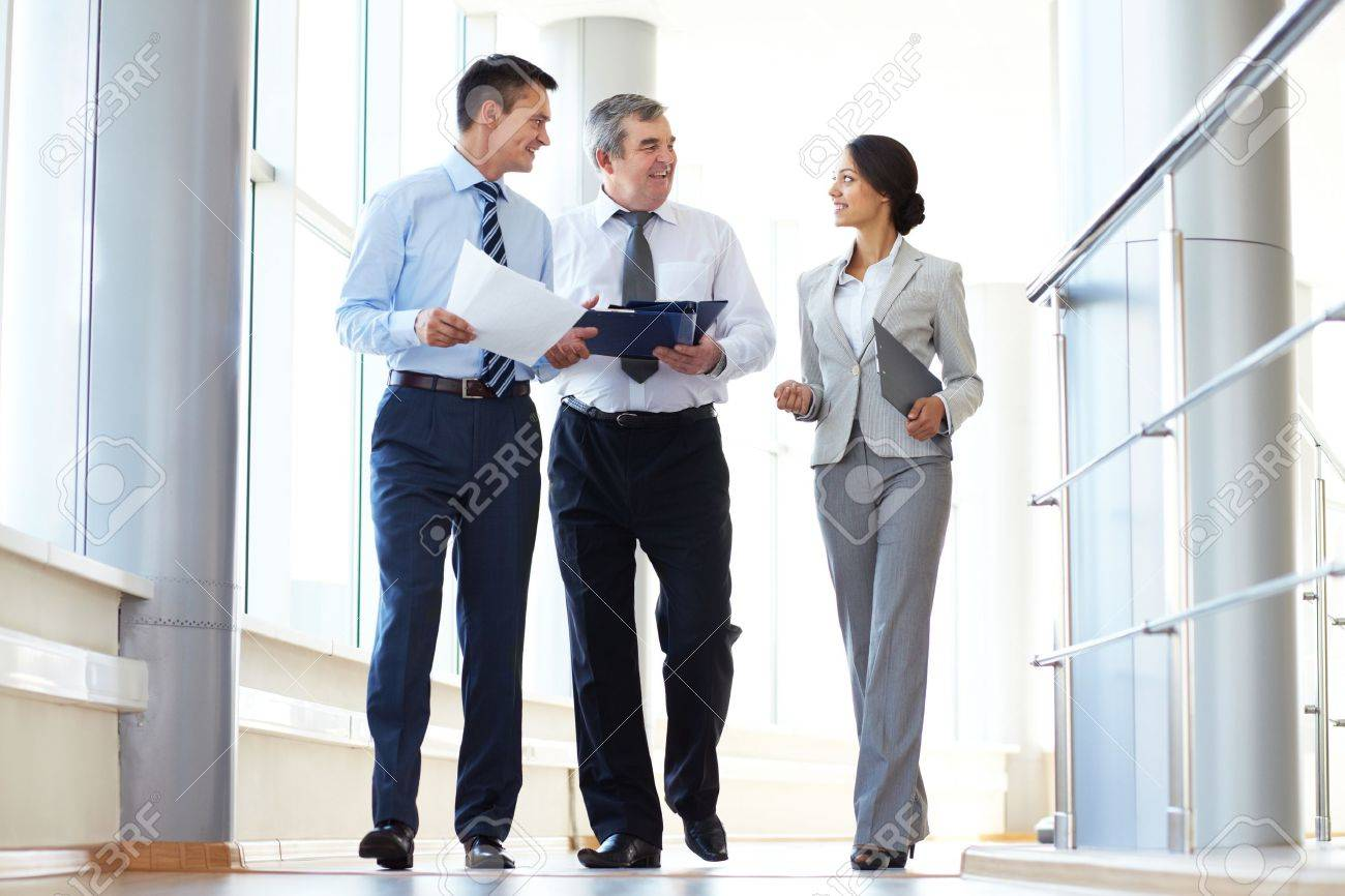 Confident business partners walking down and discussing work Stock Photo - 10944635
