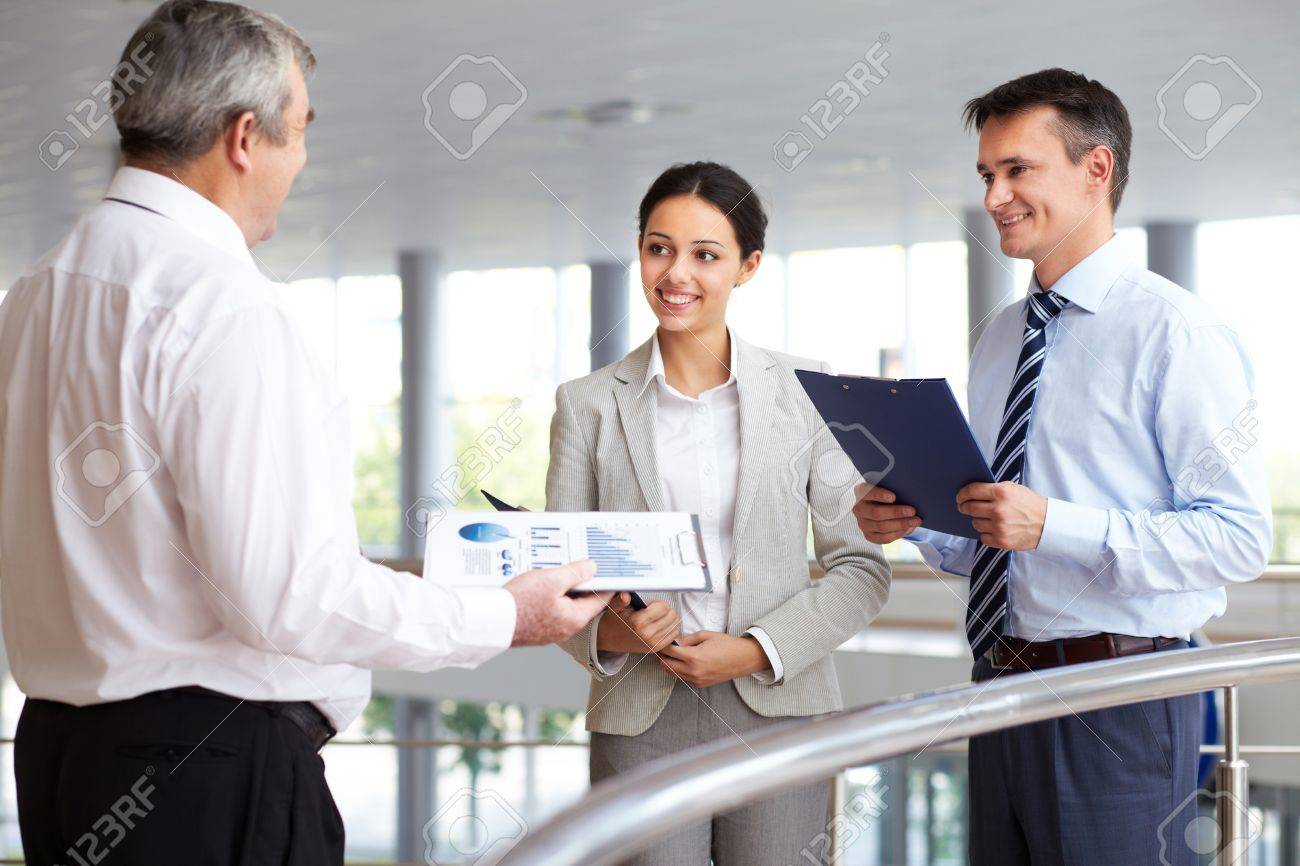Portrait of busy people discussing new working plan or idea Stock Photo - 10931458