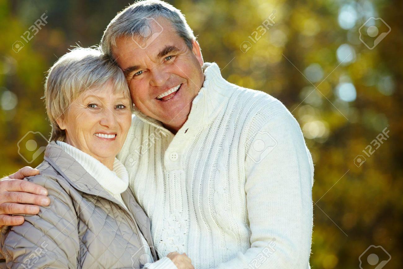 Photo of amorous aged man and woman looking at camera - 10944578
