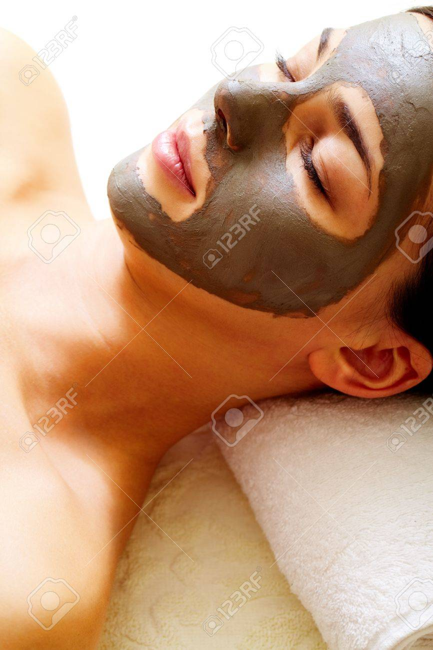 Relaxed girl having pore cleaning procedure in parlor Stock Photo - 11236353