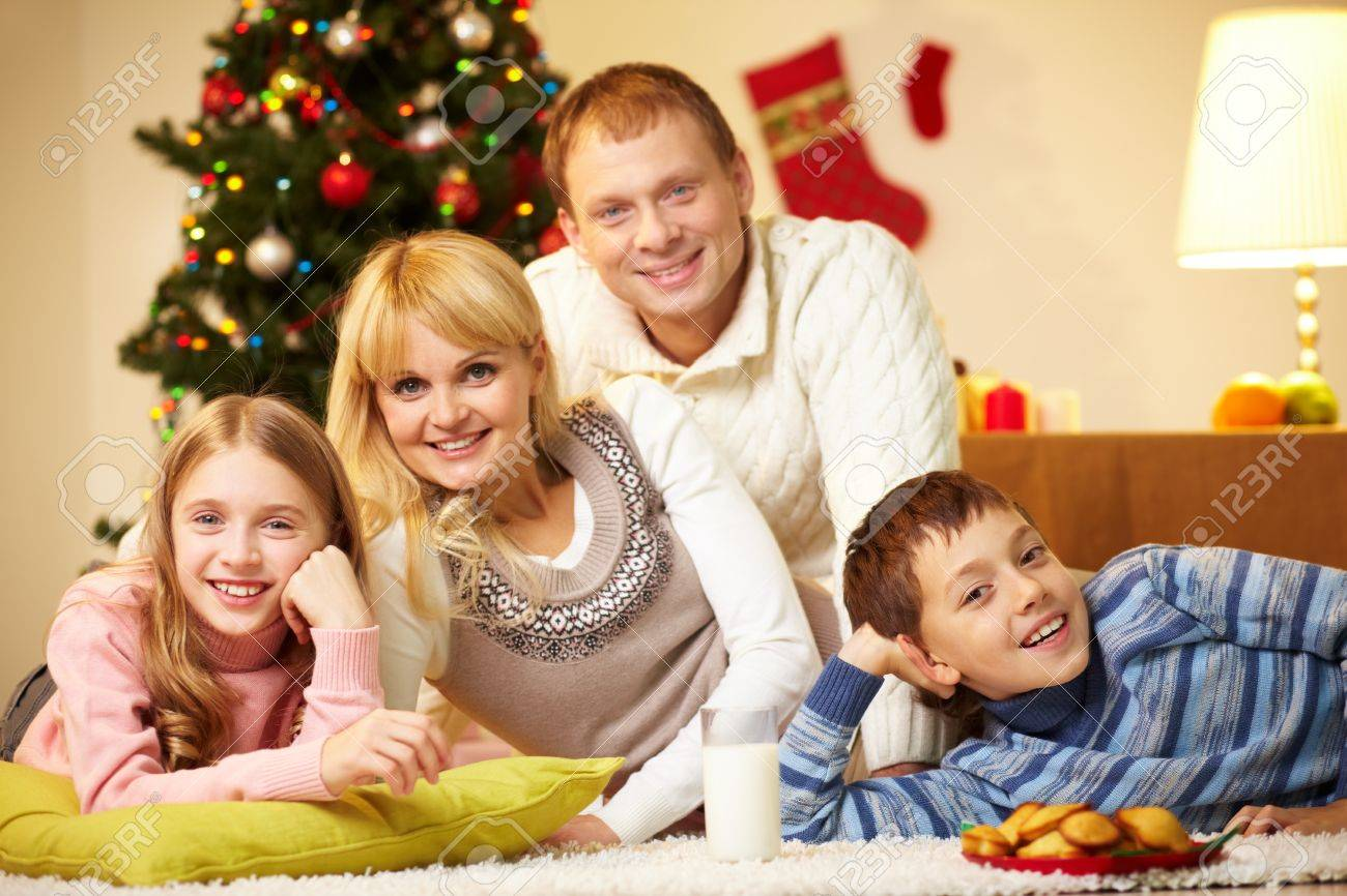Portrait of four happy family members looking at camera with smiles Stock Photo - 11236354