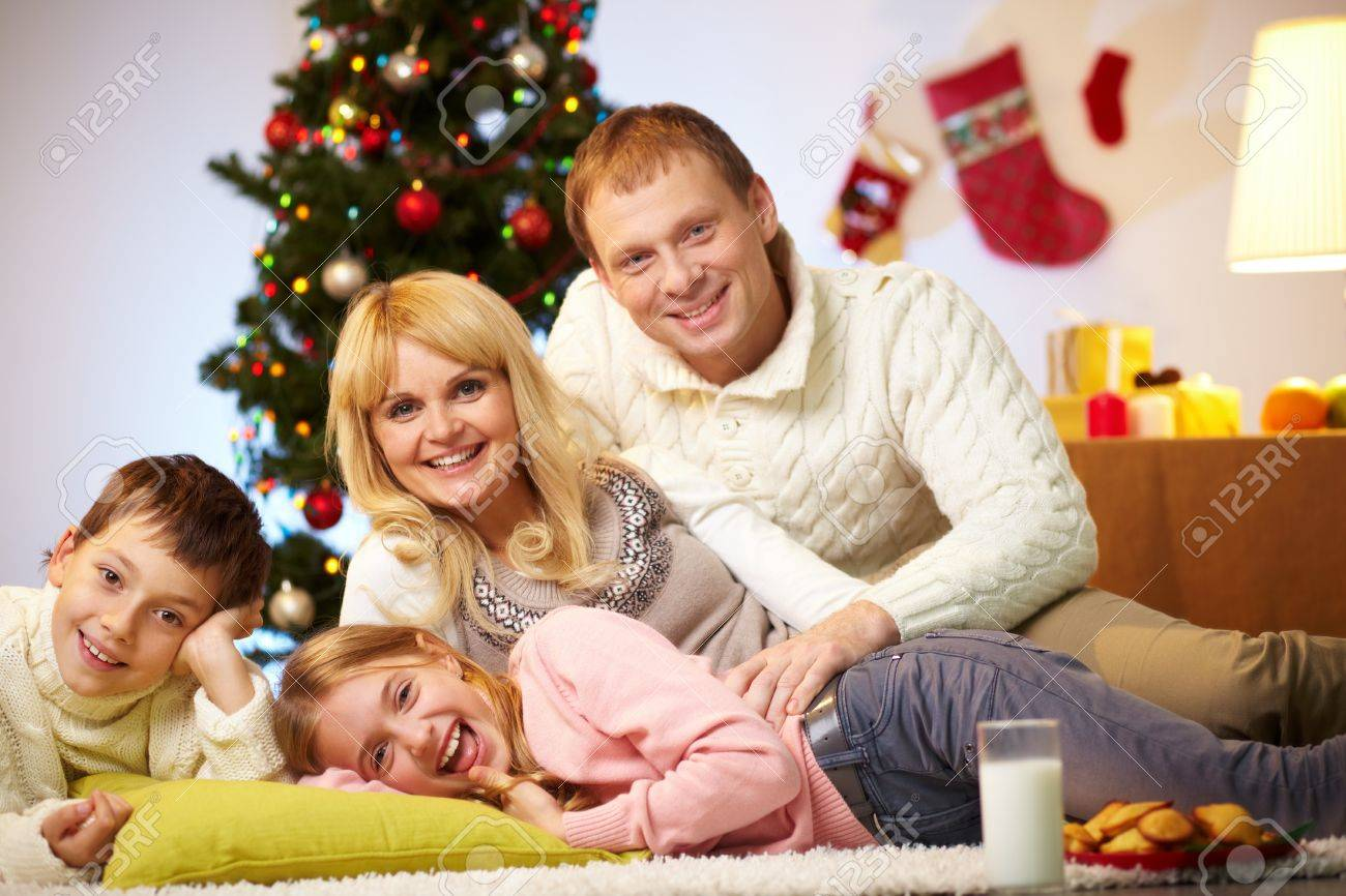 Portrait of four happy family members at home on Christmas Eve Stock Photo - 11236344