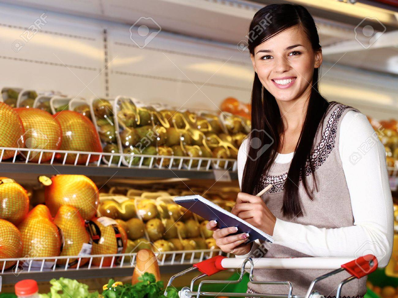 Image of pretty woman looking at camera while choosing products in supermarket Stock Photo - 11268457