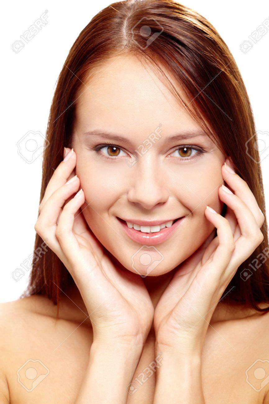 Gorgeous woman touching her face and looking at camera Stock Photo - 11622025