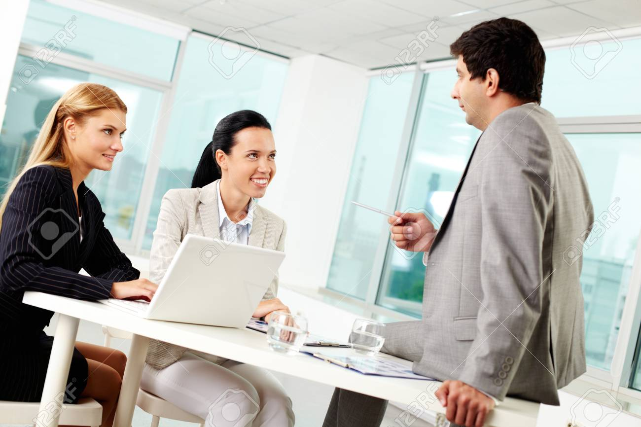 Three business people discussing ideas at workplace in office Stock Photo - 11634008