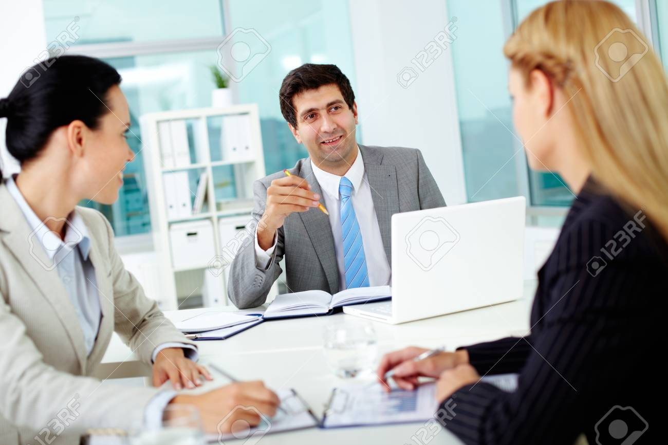 Confident businessman explaining his ideas to colleagues at meeting Stock Photo - 11920189