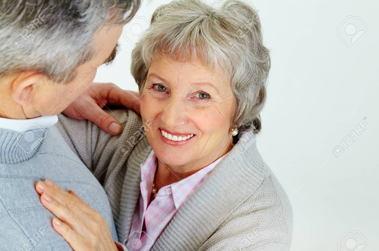 Above view of attractive aged woman looking at camera with her husband near by Stock Photo - 11920049