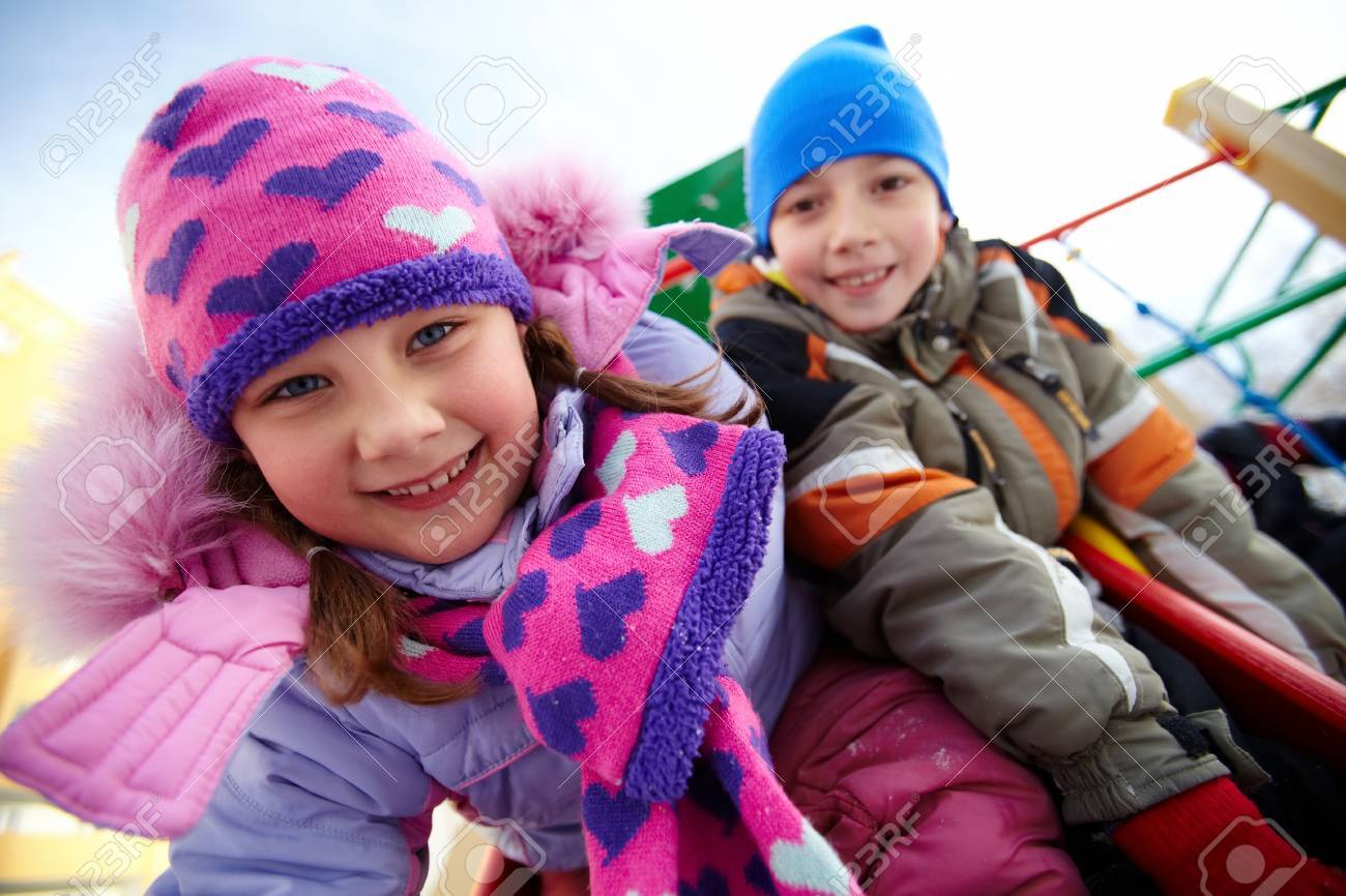 Happy girl in winterwear playing outside with her friend on background Stock Photo - 11936825