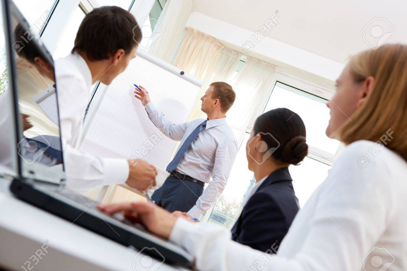 Businessman presenting the project to the team of co-workers Stock Photo - 12319527