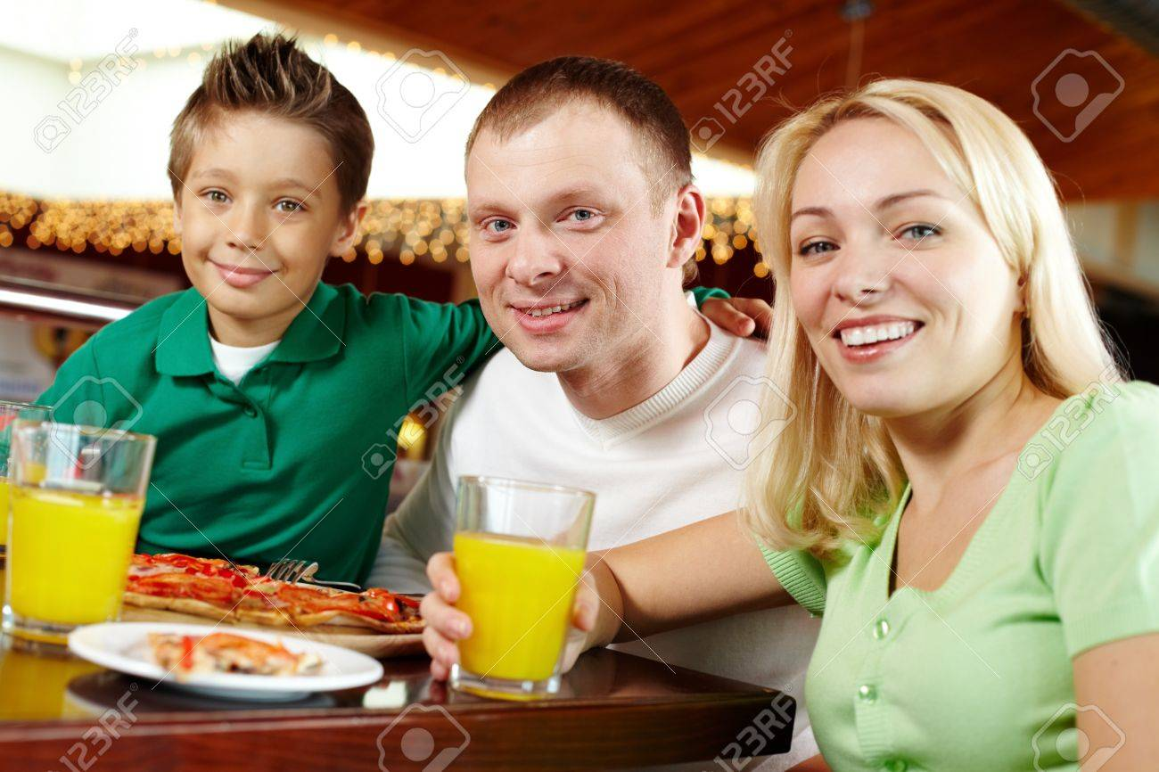 Family of three enjoying lunch at a cafe Stock Photo - 12326518