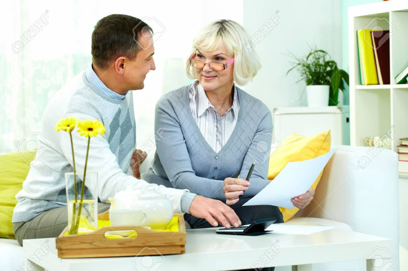 Portrait of mature man and his wife making financial revision at home Stock Photo - 12328597